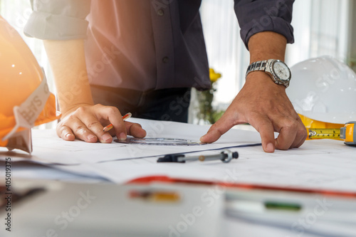 Midsection Of Architect Drawing Blueprint At Desk In Office Fototapet