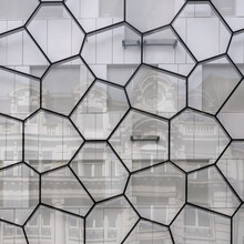 Random Polygonal Pattern On Glass Reflecting And Old Architectural Building