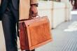 Leinwandbild Motiv Business man holding a briefcase.