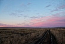 Road Amidst Field Against Sky During Sunset