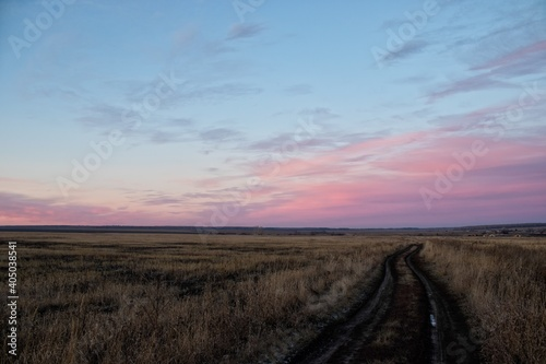 Road Amidst Field Against Sky During Sunset Fototapet