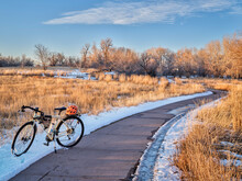 Touring Bicycle In Late Fall Or Winter Scenery - One Of Numerous Bike Trails In Fort Collins, Northern Colorado, Recreation And Commuting Concept