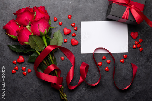 Valentines day greeting card with red rose flowers and sweets