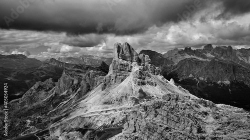 Fotografiet Scenic View Of Mountains Against Cloudy Sky