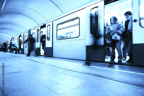 Fototapeta crowd of people metro in motion blurred, abstract background urban traffic peopl