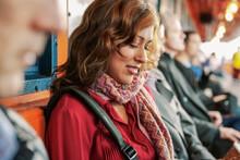 Hispanic Businesswoman Commuting On Ferry