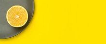 Illuminating Yellow Lemon On A Ultimate Gray Plate On A Bright Yellow Background. Colors Of The Year 2021. Trend Colors Of The Year