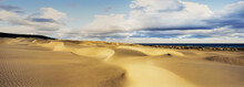 Panorama Of Large Sand Dunes Rolling Down To The Coast Meeting The Coral Sea And Dramatic Clouds In The Sky On Fraser Island - Queensland