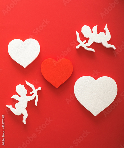 Fotografie, Tablou Flying cupid silhouette with hearts, gifts, happy Valentine's Day banners, paper art style