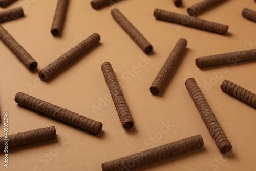 Obraz Flat lay with chocolate wafer rolls on brown background - fototapety do salonu
