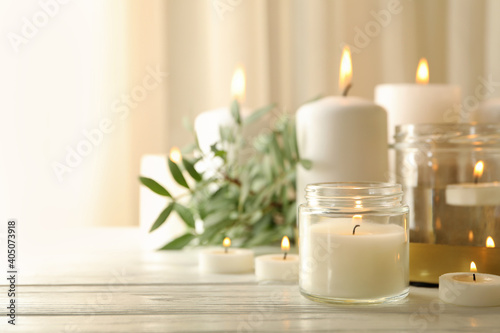 Fototapeta Burning scented candles for relax on white wooden table obraz