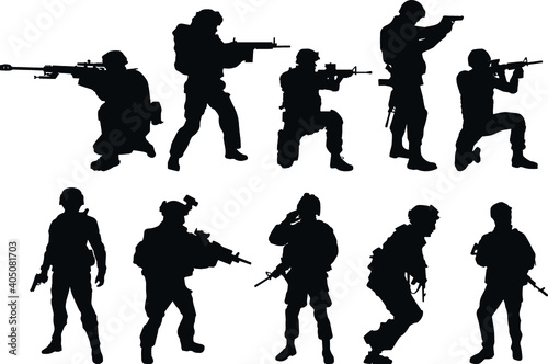 Fotografering Silhouettes of US soldiers. Silhouettes to represent soldiers.