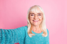 Photo Of Retired Lady Take Selfie Toothy Smile Wear Blue Pullover Specs Isolated Pink Pastel Color Background
