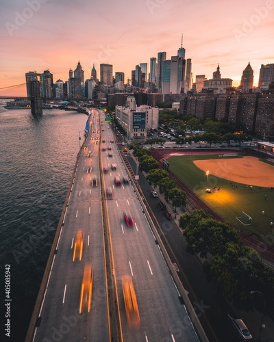 High Angle View Of Road Amidst Buildings In City During Sunset