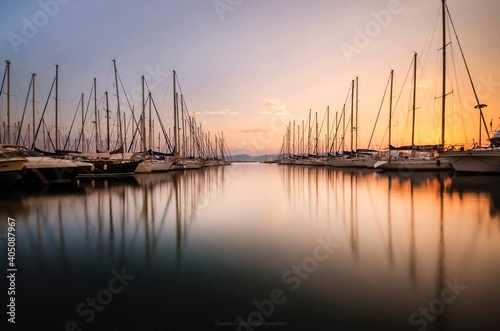 Obraz na plátně Sailboats Moored In Marina At Sunset