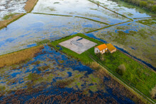 Aerial View Of Abandoned House In A Marshland