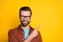 Headshot Photo Of Positive Guy In Casual Outfit Pointing Fingers Blank Space Isolated On Bright Yellow Color Background