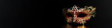 Masquerade Mask With Gemstones On Black Reflective Background Web Banner