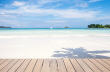Wooden Decking And Beautiful Tropical Beach And Sea Background