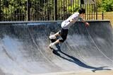Full Length Of Teenage Boy Skateboarding At Park