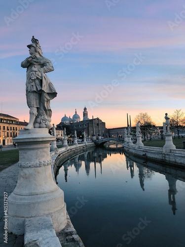 Obraz na plátně Statue By River During Sunset