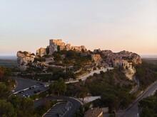 Aerial Sunset Panorama Of Medieval Historic Rock Castle Town Les Baux-de-Provence In Provence Alpes Cote DAzur France