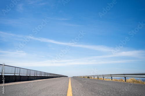Highway with blue sky A long road that stretches far