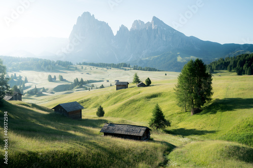 Scenic alpine landscape with mountain huts in the Alps at sunrise in summer
