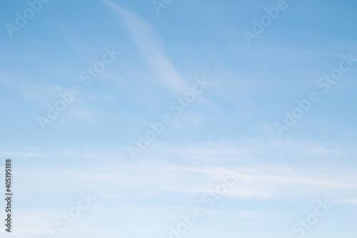 Obraz blue sky with a haze of white clouds - fototapety do salonu