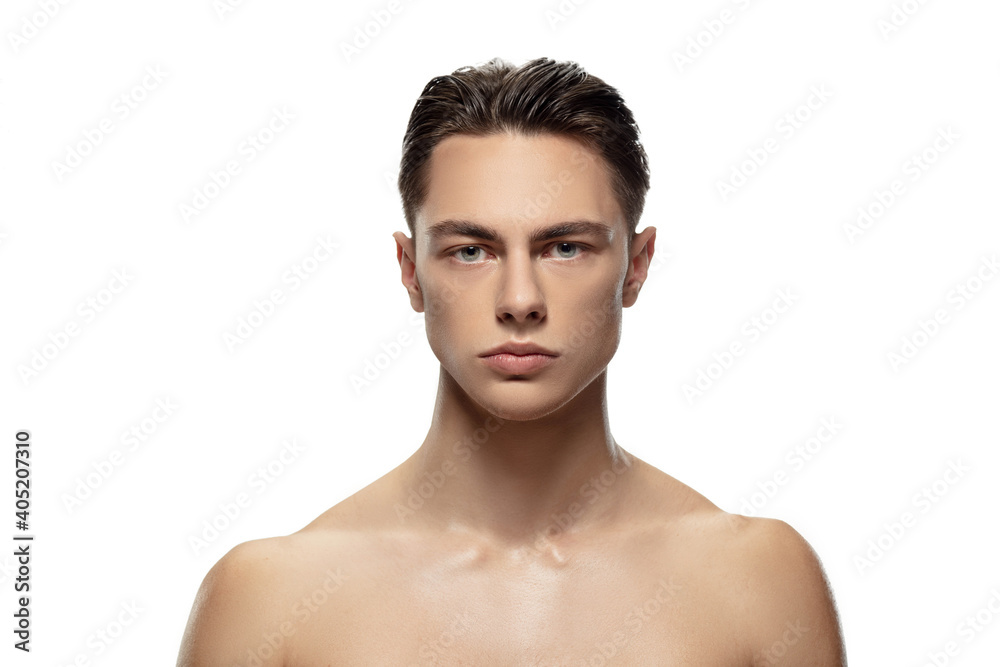 Fototapeta Anger. Portrait of young man isolated on white studio background. Caucasian attractive male model. Concept of fashion and beauty, self-care, body and skin care. Handsome boy with well-kept skin.