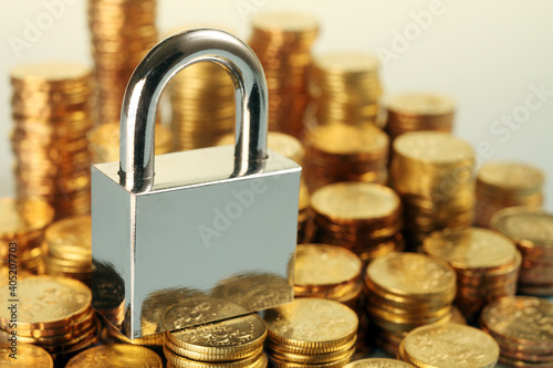 Fototapeta Close-up Of Coins And Padlock obraz