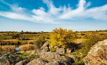 Beautiful Yellowed Vegetation And Stones Covered With Lichen And Moss Hills In Picturesque Ukraine