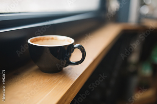 Fotografiet Close-up Of Coffee Cup On Window Sill