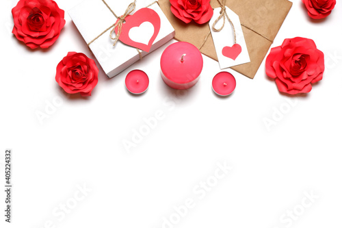 Love, Valentine's, women's day, relations, romantic template from white gift box and gift wrapped in craft paper, tied with twine with bows and labels with red hearts, roses, candles white background