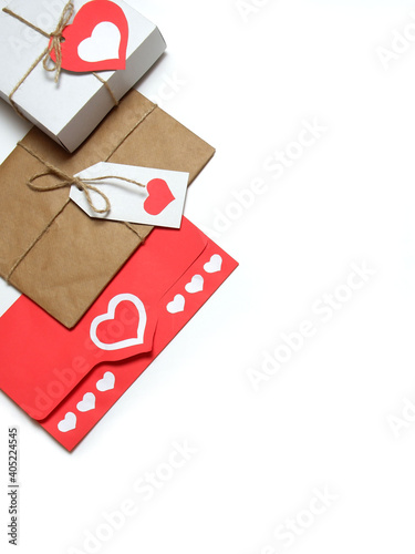 Gifts, tied with twine with bows and labels with red paper hearts, love letter in red envelope with hearts on white background isolated. Love, Valentine's, women's day, relations, romantic concept
