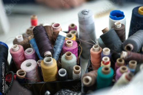 Closeup shot of colorful rolls of thread Fototapeta