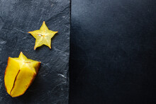 Carambola Fresh Star Fruit Slices Ready To Eat On The Table Healthy Meal Snack Outdoor Top View Copy Space For Text Food Background Rustic Image Keto Or Paleo Diet