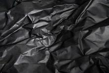Artfully Crumpled Black Paper Background