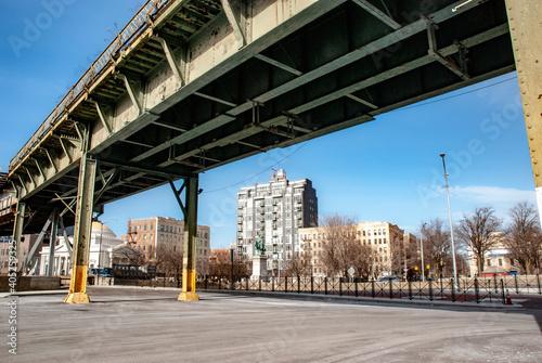 Obraz na płótnie Low Angle View Of Bridge By Buildings Against Sky