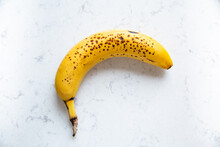Ripe Banana On A Marble Kitchen Counter.