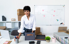 Portrait Of Businesswoman Organizing Office Before Relocation