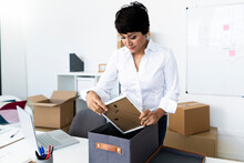 Businesswoman Organizing Office Before Relocation