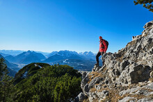 Male Hiker Admiring Surrounding Landscape Of Karwendel Mountains