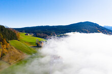 Drone View Of Mountain Valley Shrouded In Thick Fog
