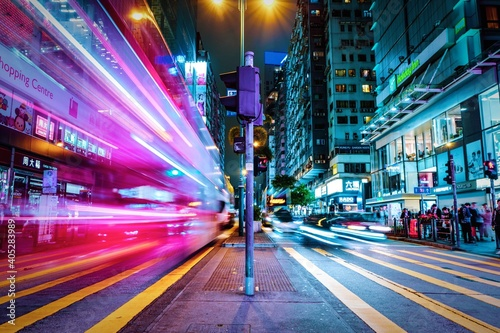 Fotografia, Obraz Light Trails On City Street Amidst Buildings At Night