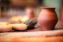 Close-up Of Rolling Pin And Pot On Table