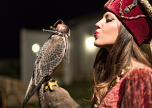 Woman In Traditional Clothing Holding Falcon During Halloween