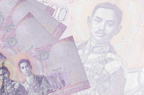 Canvas-taulu 500 Thai baht bills lies in stack on background of big semi-transparent banknote