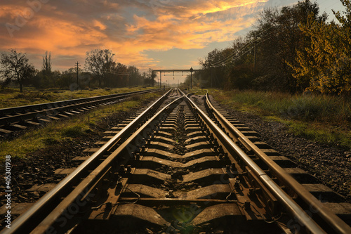 Railway lines in countryside on sunny day. Train journey Fotobehang