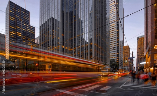 Light Trails On City Street By Buildings At Dusk Fototapeta